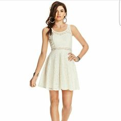 Lace summer dress Skater style lace dress. Completely lined except for small band around waist. American Rag Dresses Mini