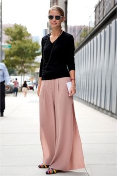 love the effortless look of black sweater and cute long skirt. good stuff for fall
