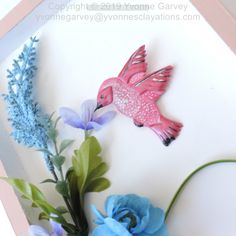 """Humming birds are such a small beautiful bird with personality. This handmade brooch is made from polymer clay and hand painted with acrylic paint.  It will look great with many types and colours of clothing.   It is approximate 2-1/2"""" by 2 1/2"""" x 1/2"""" inch and weighs 7  grams.    Each one is individually handmade so they will each be unique. Materials: Polymer clay, acrylic paint, and a brooch pin. Check out my website for more info by clicking on the photo. Price is under $25.00…"""