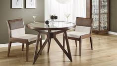 A mesa do conjunto Tuniz pode ser em dois tamanhos diferentes, conforme o seu ambiente e necessidade! O tampo é de vidro temperado. As cadeiras possuem o assento com espuma D-28 e encosto com espuma D-20 com rattan casca. A linha possui a estrutura em madeira de marupá, acabamento em poliuretano e os revestimentos de tecidos de diversos padrões, conforme nosso mostruário. Medidas Mesa maior: 100L x 74A  x 100P. Mesa menor: 80L x 74A x 80P. Cadeira: 48L x 80A x 58P…