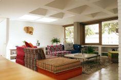Living Room. Concrete Floor, Roche Bobois Furniture, White Break, Teak.