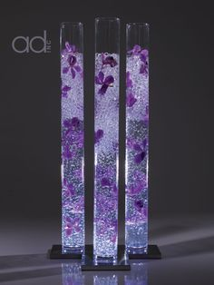 Purple flower, clear water pearls in cylinder vases   designed by Hitomi Gilliam
