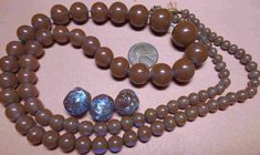 Strand of Victorian Saphiret beads and 3 Saphiret foil beads.
