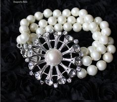 Three layers of the pearl flower bracelet. If you love it, just repin it.  You know, it is very hot-sale. Just get it at $10.5 under promotion at that time from dearoy.com