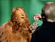 *THE COWARDLY LION (Bert Lahr) & THE GREAT & POWERFUL OZ ( Frank Morgan) ~ The Wizard of Oz (1939) - Receiving a badge of Courage....