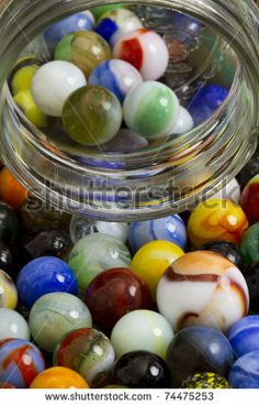 Old marbles with glass jar.