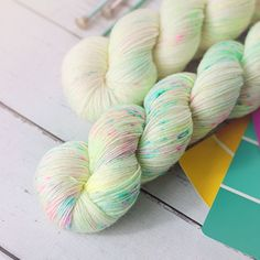 Comet   Yarn Love All the decadence of a funfetti cake with none of the guilt. Pastel citrine and aqua dance underneath a heavy freckling of hot pink, yellow, and bright turquoise