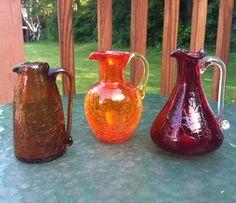 Vintage colored hand blown crackle glass cruets / pitchers