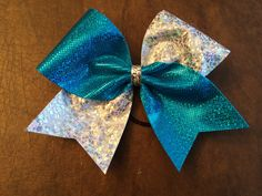 Turquoise and Silver cheer bow Etsy.com/shop/fullbidbows
