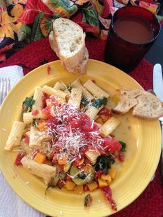 Pasta with Squash Medley and Crusty Italian bread!  Lightly sprinkled Fresh Parmesan is optional.