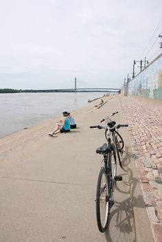 Taking a break after biking on the banks of the river in Cape Girardeau = family bonding.