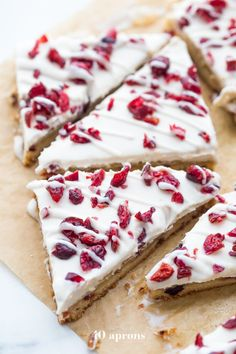 These paleo cranberry bliss bars are just that: bliss! These vegan cranberry bliss bars are a healthy Starbucks copycat recipe perfect for the holidays.
