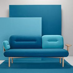 Hand-upholstered three-seater sofa with integrated wooden drinks tray: http://www.dezeen.com/2015/02/12/la-selva-cosmo-sofa-missana-wooden-tray-replaces-one-arm/ … #design