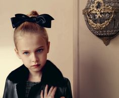 Even the black leather jackets are luxe at Baby Dior kidswear for fall/winter 2015