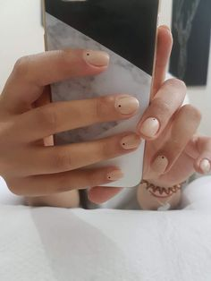 Minimal nude nails with dot detail