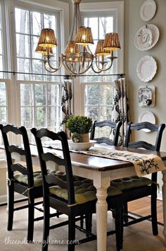 .. nice dining space .. love the dark chairs with lighter farmhouse table