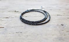 Minimalist black spinel necklace. Black spinel triple wrap bracelet. by MarisaBecca on Etsy https://www.etsy.com/listing/234012005/minimalist-black-spinel-necklace-black