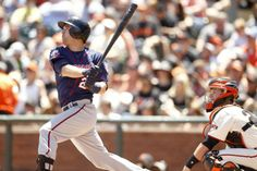 May 25, 2014; San Francisco, CA, USA; Minnesota Twins infielder Brian Dozier (2) hits a sacrifice fly against the San Francisco Giants in the third inning at AT&T Park. Mandatory Credit: Cary Edmondson-USA TODAY Sports