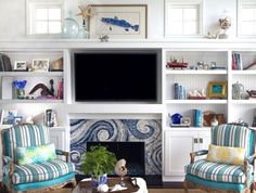 Coronado Beach Cottage Love the surfs up tile surround on the fireplace. Try something similar in living room