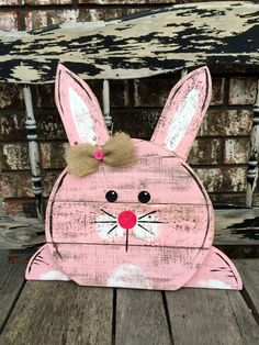 This Reclaimed Wooden Bunny is perfect for anywhere in your home. Hang on the wall, your front door or simply let it lean on your mantle/shelf. This order is for one Handmade Bunny sign made from reclaimed pallet wood. Two colors to chose from, pink or blue. Each bunny has a burlap