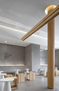 Images by Xiaole Cheng. The design is located in Foshan, the hometown of martial arts, where was once famous for Wing Chun. UND tries to integrate modern aesthetics with. Coffee Shop Interior Design, Coffee Shop Design, Restaurant Interior Design, Modern Restaurant, Modern Cafe, Modern Store, Design Apartment, Retail Store Design, Bakery Design