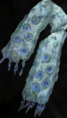 Nuno felted hand dyed silk scarve.  hand beaded.