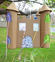 Fun and easy castle pinata- each kid pulls candy through a window rather than busting it open and ensuing chaos