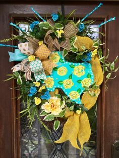 Yellow rose of Texas wreath with florals and ribbons.  Bright turquoise and yellow colors!