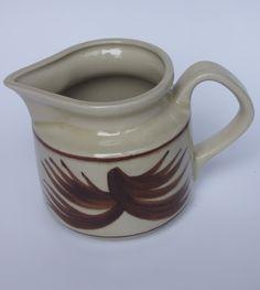 Vintage Milk Jug / Pitcher / Ceramic / Cream Choc Brown / Glazed / Hand painted / Made in Poland / Polish folk craft / Polish pottery #etsy #polishpottery #handpainted #milkjug #jug #vintage #vintagejug  Shop on: etsy.com/shop/VintagePolkaShop