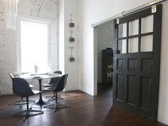 An oversized reclaimed barn door in a studio by Patrick Davis Design.