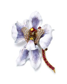 An antique enamel, ruby and diamond orchid brooch, by Tiffany & Co. Photo courtesy of Christie's.