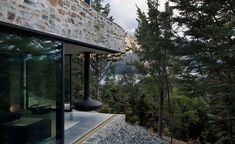 Modern stone and glass mountain retreat in New Zealand