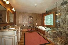 I love this bathroom (minus the rug)...clear showers are sweet.