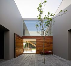 Portuguese firm Frederico Valsassina Arquitectos  has completed 'house in quinta patino' in Estoril, Portugal.  The rectangular footprint arranges the living spaces within a modular arrangement of compartments and openings, integrating outdoor   courtyards into the internal configuration.