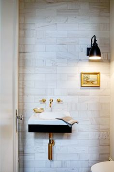 for powder room: modern floating sink - interesting light fixture and art - gold fixtures also interesting. This is my powder room. Gold Fixtures, Wall Mount Faucet, Bathroom Inspiration, Bathroom Decor, Bathrooms Remodel, Powder Room Sink, Kitchen And Bath, Bathroom Design, Tiny Powder Rooms