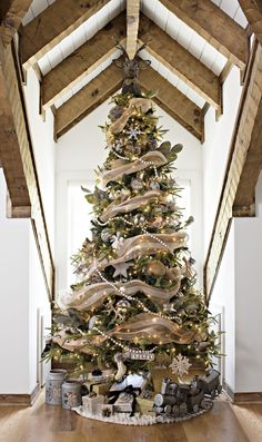 Get creative with your Christmas tree this year! Tuck Christmas decor underneath the tree and alongside the presents, and replace your traditional tree topper with something a bit more rustic!