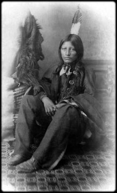 Sitting portrait of a young, unidentified Native American man at the Carlisle Indian School, Carlisle, Pennsylvania. Photographed between 1880 and 1900.