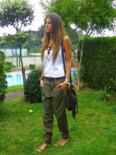 Love the tank look. Not sure about the baggy pants but dark green skinnies would be so cute with the top and necklace Mode Outfits, Casual Outfits, Fashion Outfits, Fashion Trends, Fashion Weeks, Camo Fashion, Sporty Fashion, Milan Fashion, Look Boho Chic