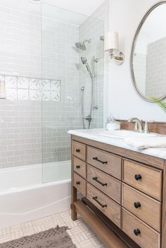 Even though we enlarged the master bath, it still isn't huge. We maximized it by having our cabinet maker, Marvin, build a beautiful custom vanity that didn't take up precious space. It has a classic design, and its size helped the bathroom feel roomy without skimping on storage space.