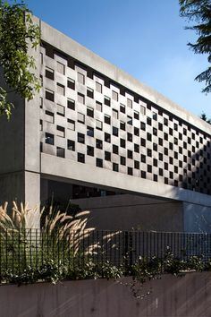 Perforated screens cast patterns of light and shadow in concrete house by Pitsou Kedem