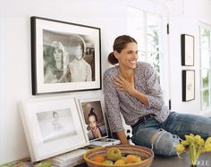 Amanda Peet next to a Mary Ellen Mark photograph (top) of Jessica Lange and Dustin Hoffman, in drag in Tootsie (her all-time favorite movie)—a birthday present from her husband.