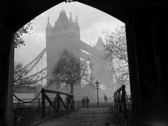 Unknown Photographer, A misty view of London's tower bridge seen from an archway in the nearby tower, 1932