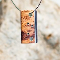 A personal favorite from my Etsy shop https://www.etsy.com/listing/246385621/burl-mango-and-wenge-reversible-pendant