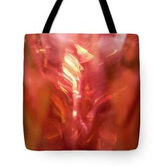 Fire Energy Tote Bag by Jane Star.  The tote bag is machine washable, available in three different sizes, and includes a black strap for easy carrying on your shoulder.  All totes are available for worldwide shipping and include a money-back guarantee.