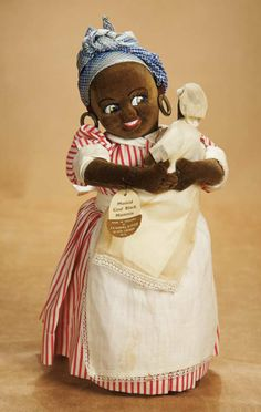 "1935 , Mammie Doll carrying a original brown velvet baby in original costume. ""Musical Coal Black Mammie, Made in England by J.K. Farnell"" (original paper label). Excellent condition except music not working, bandana faded. Farnell, circa1935, rare doll."