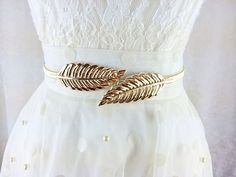 This is a Greek Goddess vintage inspired leaf belt. It is stunning and gives an elegant accent to your wedding dress or evening dress. It s versatile