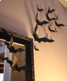 Bats -- I've done this for the past two years. The bats can be stored flat to be used for the following year. It is definitely creepy and everyone loves them. You can also do this around your door outside or on railings, etc.