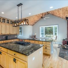 Rustic/Modern accents throughout, including maple hardwood flooring, custom tile and stonework, elegant lighting fixtures, cathedral wood ceilings, granite counter tops, center island, cooktop, breakfast room and sunroom. Listed by The Casey Samson Team, a Wall Street Journal Top Team in Northern Virginia.