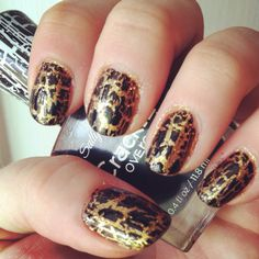 My nails today. Black crackle over gold glitter. I know some people think Crackle looks tacky, but I think it's amazing!