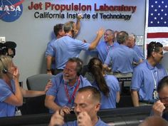 Cheers for Curiosity  Engineers at NASA's Jet Propulsion Laboratory in Pasadena, Calif., celebrate the landing of NASA's Curiosity rover on the Red Planet. The rover touched down on Mars the evening of Aug. 5 PDT (morning of Aug. 6 EDT). Image credit: NASA/JPL-Caltech